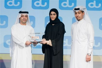 Ameena Ahmadi, Architecture Manager at Qatar Foundation Capital Projects and Facilities Management, receiving the award.jpg