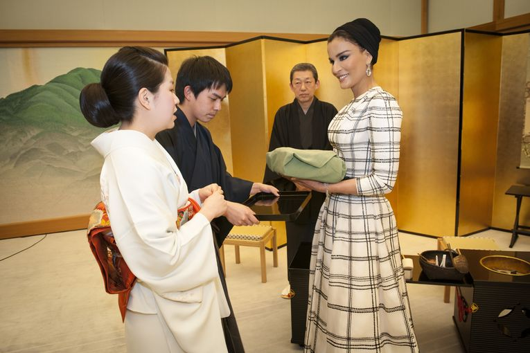 Her Highness Sheikha Moza bint Nasser is introduced to a traditional Japanese tea ceremony at the Kyoto State Guest House..jpg
