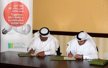 Left to Right - Mr. Ahmad Al Jolo, Chairman of QSE and Engineer Meshal Al Shamari, Director of QGBC, signing the MoU.JPG