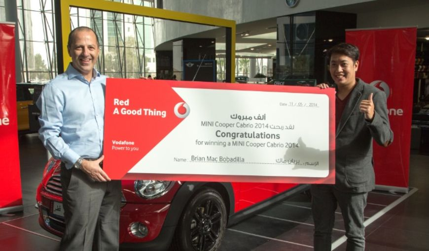 Marc Norris, Chief Commercial Officer, with RED MINI COOPER Winner