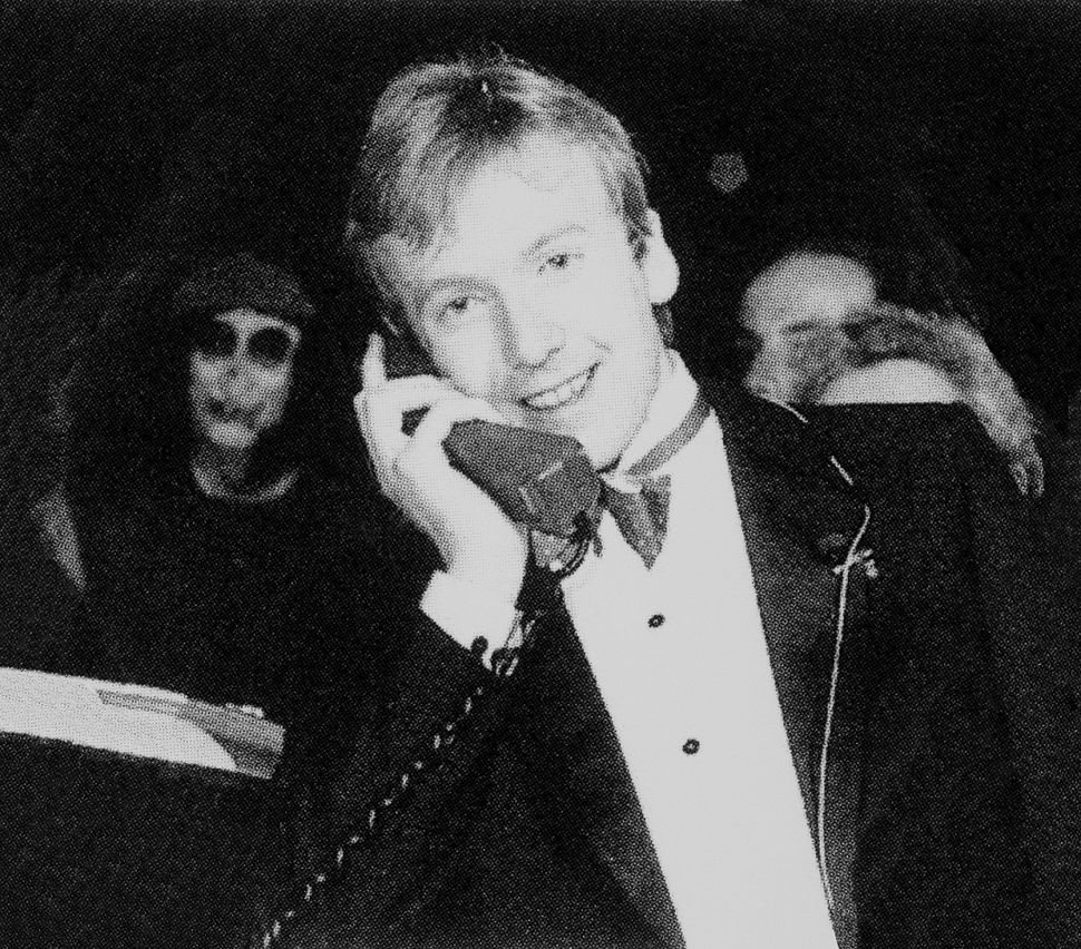 Michael_Harrison_making_the_UK's_first_mobile_call_using_a_Vodafone_VT1_Transportable_phone,_1st_January_1985.jpg