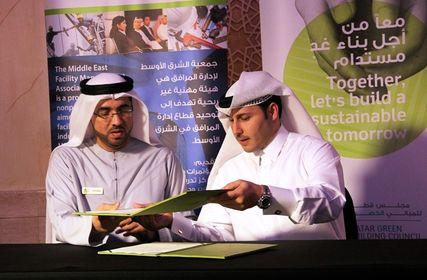 QGBC Director Engineer Meshal Al Shamari and Mr Ali Al Suwaidi, a member of MEFMA's Board of Directors, signing the MoU.JPG