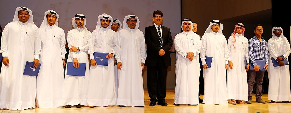 QNRF officials with some of the winners from the third cycle of the Secondary School Research Experience Program.jpg