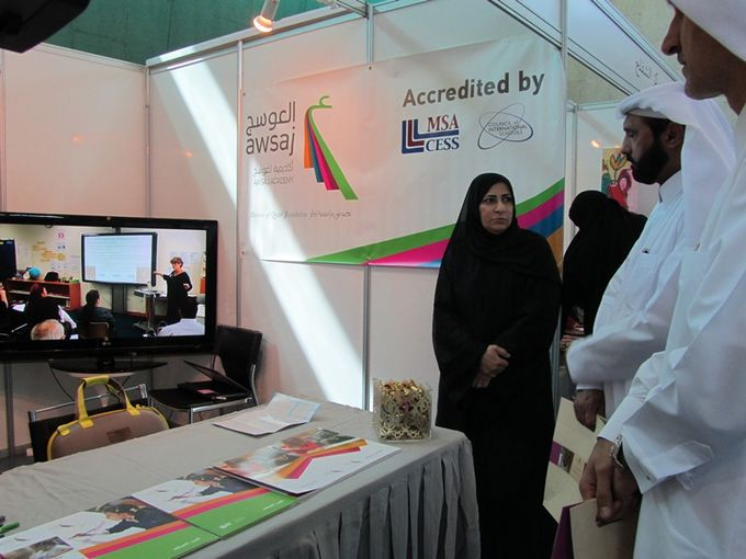 Representatives from the Ministry of Labour and Social Affairs during their visit of Awsaj Academy booth- Copy.jpg