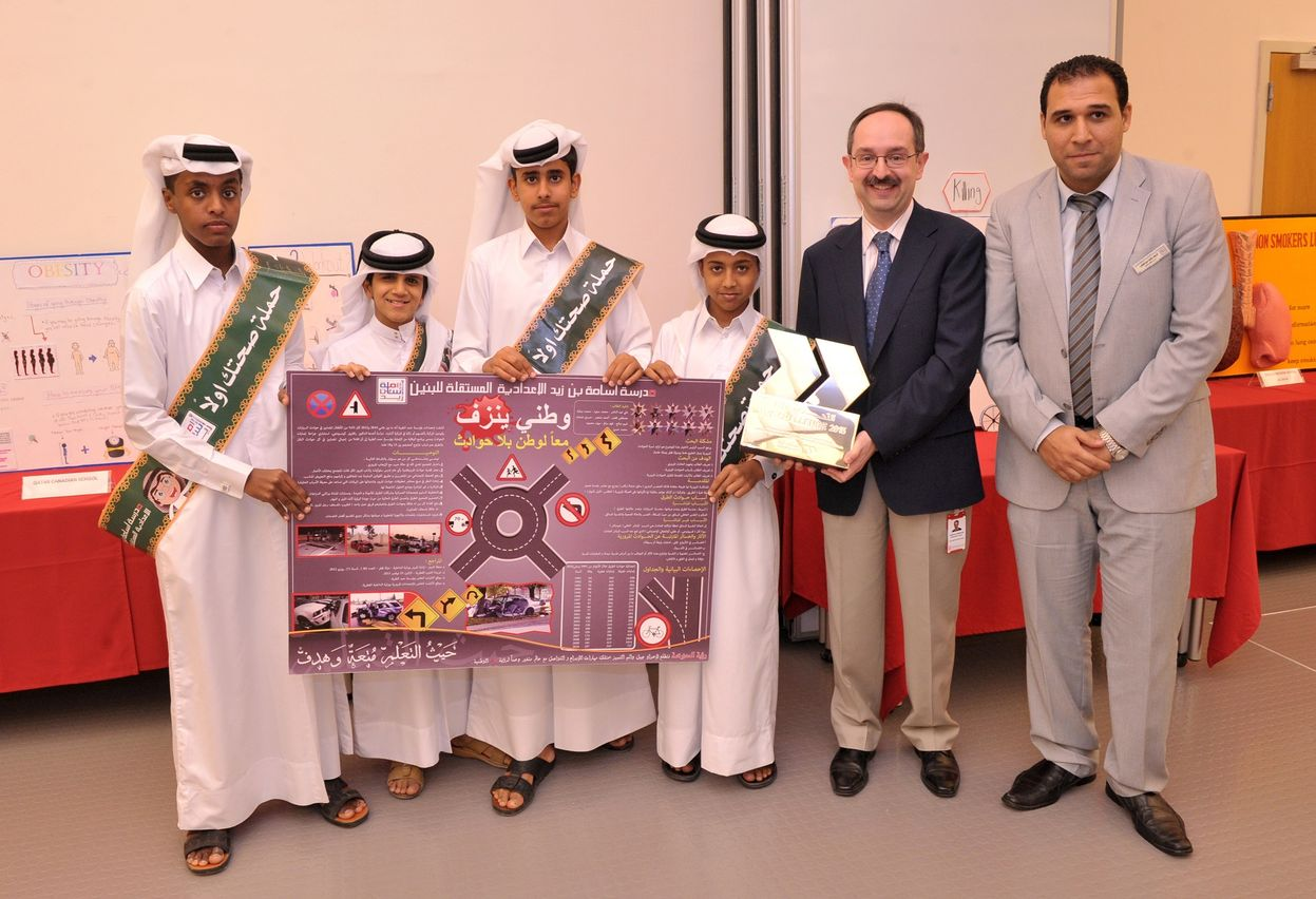 Students from Ossama Bin Zaid Independent School receiving the prize from Dr. Marco Ameduri WCMC-Q's Associate Dean for Pre-Medical Education.jpg
