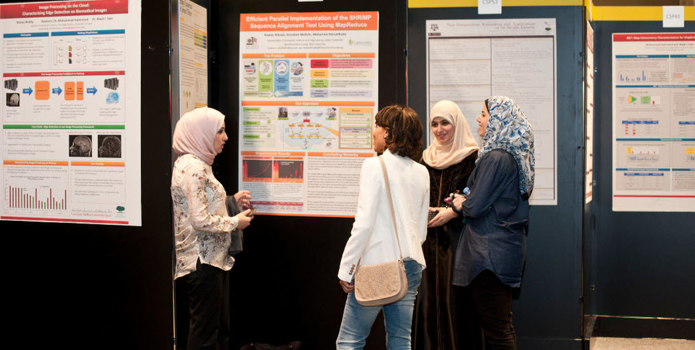 Students presenting their work at last year's Annual Research Forum.jpg