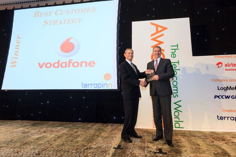 Vodafone Qatar CEO Kyle Whitehill receiving TWME Award.jpg